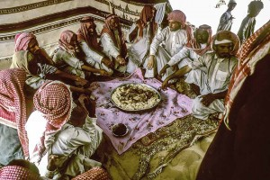 Al-Murrah Bedouins about to dig into the camel meat and rice feast. Saudi Arabia Empty Quarter (Rub al-Khali). W10224