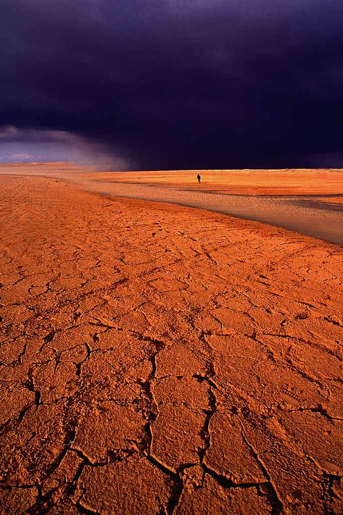 Dramatic stormy sky in Jordanian desert . Ground cracked after a deluge - another storm threatening. W5625