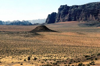 Jordan's Wadi Rum desert. One of the most spectacular areas of the country. Riders on camels are Bedouin from Desert Police. W9054