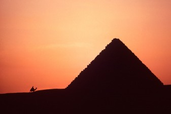Silhouette of Menkaure Pyramid and camel rider at sunset, Giza. W0381