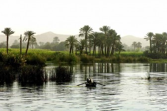 Fishermen seen in a morning mist on the Nile south of Edfu