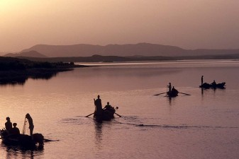Fishermen casting their nets at dawn on Lake Nasser, also called the High Dam Lake. W3366