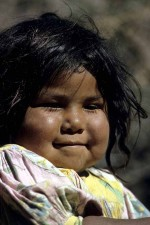 Mexico. Very young Tarahumara girl releases a little smile. She had just been crying. W3387
