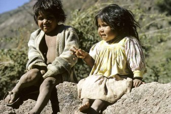 Mexixco. Tarahumara Indian brother and sister. This tribe loves sitting on rocks, the higher the better. W3388