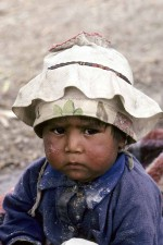 Mexico. This little Sierra Tarahumara Indian boy is Juanito. A bit disgruntled in his two hats. W3390