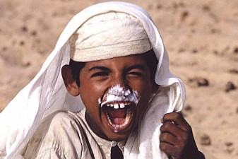 Al-Murrah Bedouin boy covered in camel's milk froth in the Rub al-Khali, Saudi Arabia's Empty Quarter. W6030