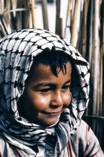 A happy young Marsh Arab boy, Iraq 1967, prior to the draining of the marshes. W8089
