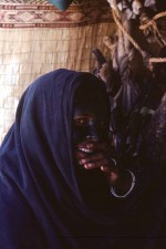 A rare shot of a young Tuareg woman at home, face covered with henna. Near Tamanrasset, Algeria. W5874