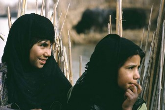 Marsh Arab girls watching their mother weaving. Iraq 1967, prior to the draining of their marshes. W8685